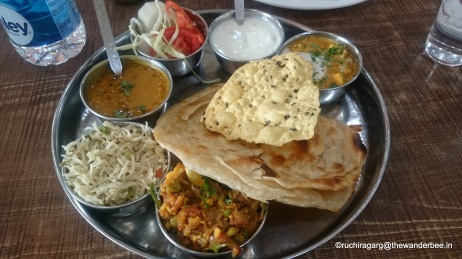 Lipsmacking veg thali with dollops of butter